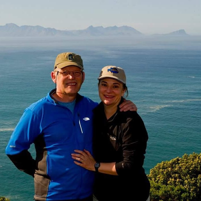 Chuck Bergman and Susan Mann in front of the ocean in South Africa in 2011, their 10th anniversary