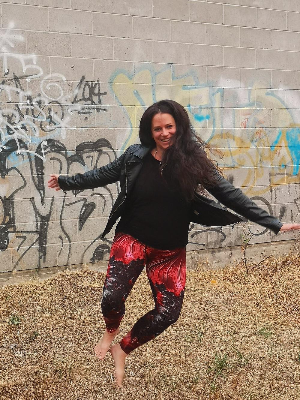 Cindy Van Arnam jumping in the air, barefoot