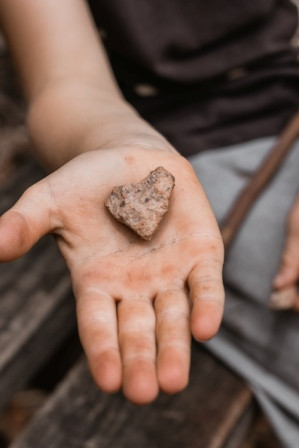 Heart-shaped rock in hand|Grief and Mourning in the Time of COVID-19