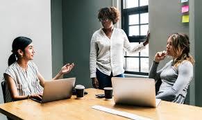 Women talking in an office
