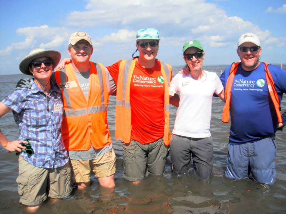 Elisa, second from right, building oyster reefs in     Alabama with The Nature Conservancy and CH2M colleagues, including  Sustainability Director Brandy Wilson, far left