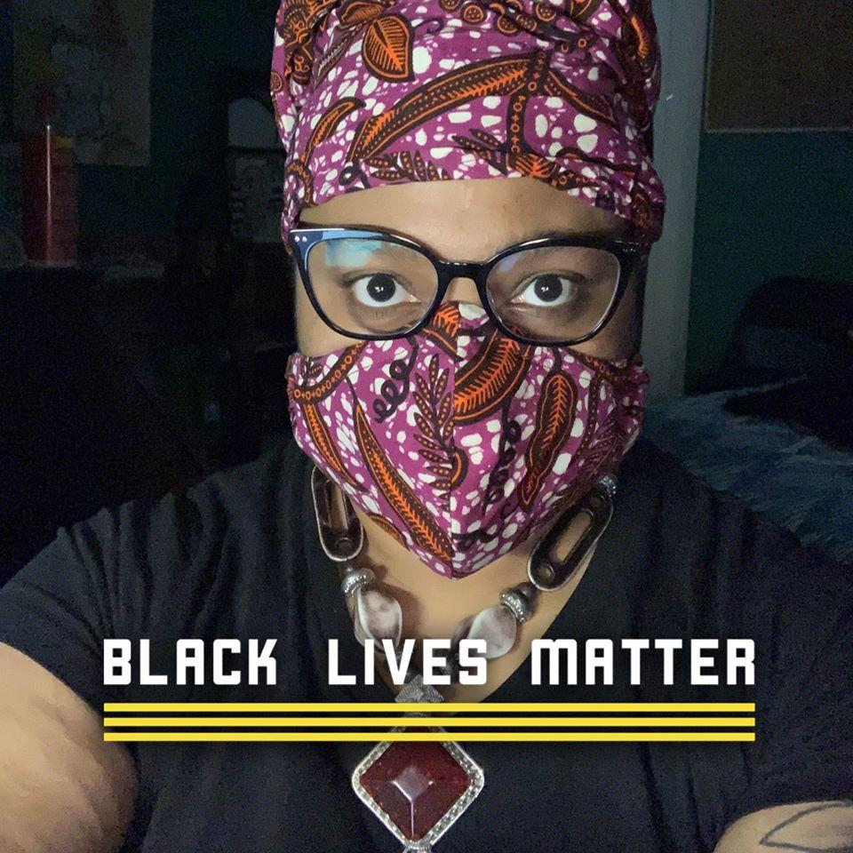 Jewels Pedersen in mask, with Black Lives Matter sign