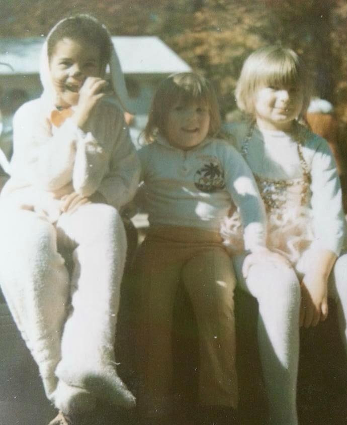 Julie as a child with white friends