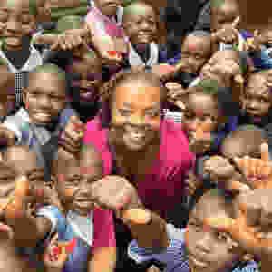 Dennett Edwards with children in Africa