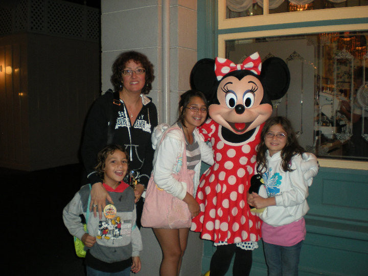 Muriel with her young kids and Minnie Mouse