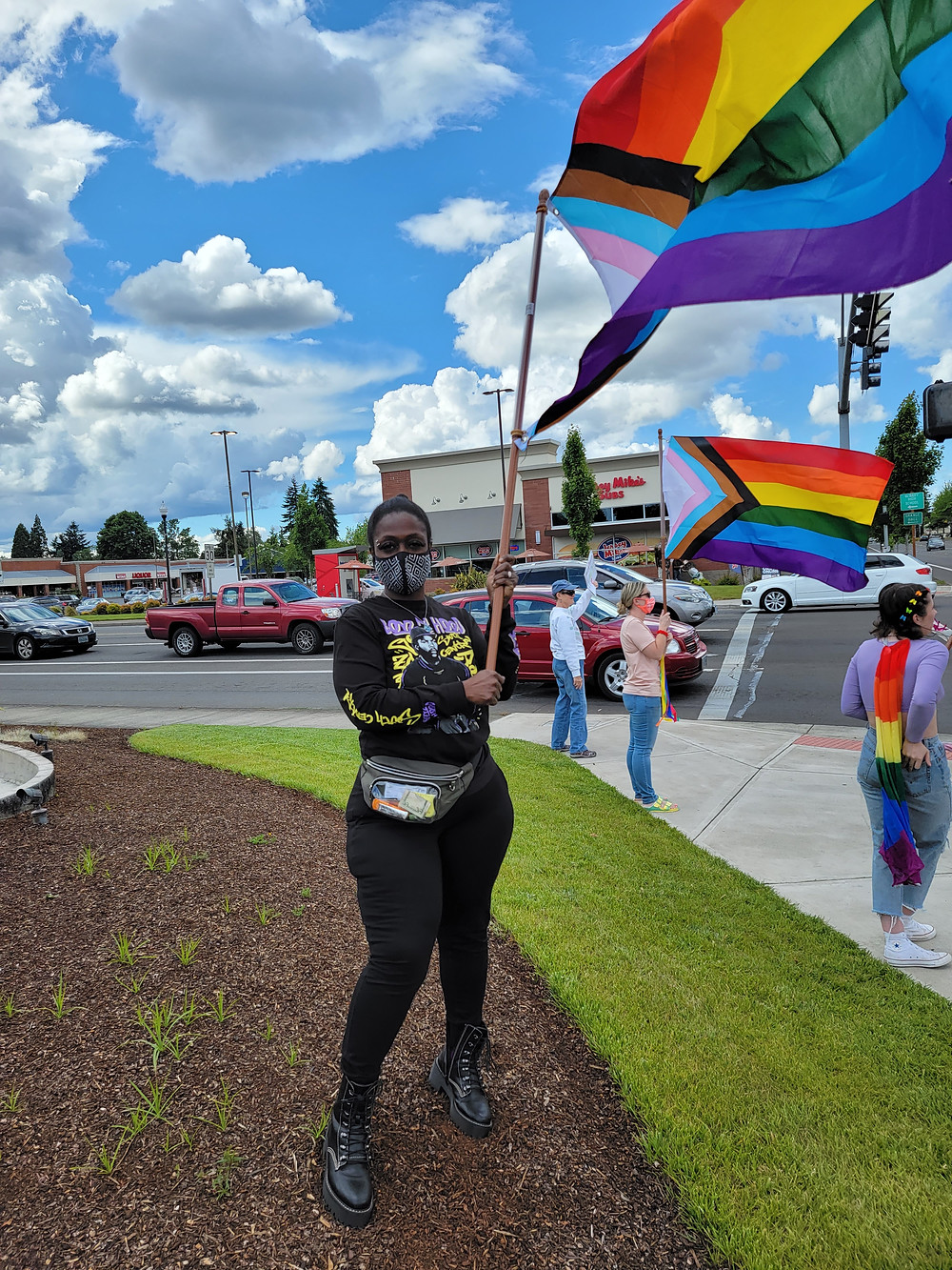 Amira holding a Pride flag