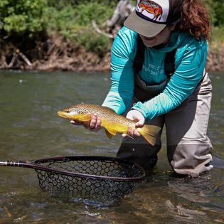 Elena catching a fish
