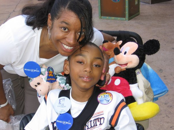 Joy and Amir at Disneyworld with the Make a Wish Foundation