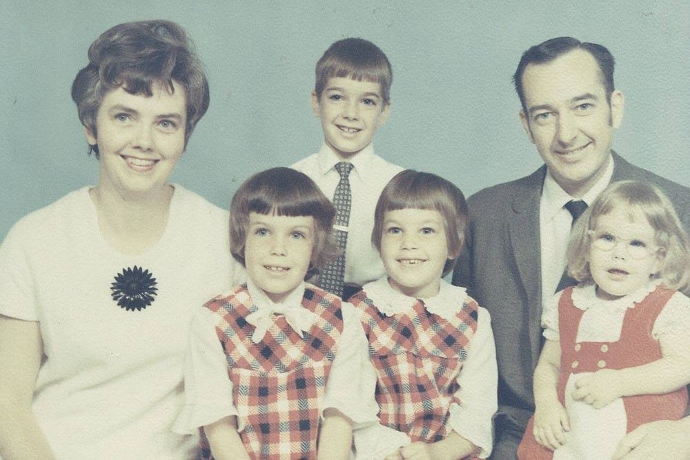 Cathy (next to her mom) with her parents and three of her siblings