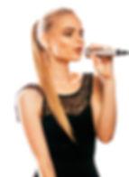 young pretty blond woman singing in micr