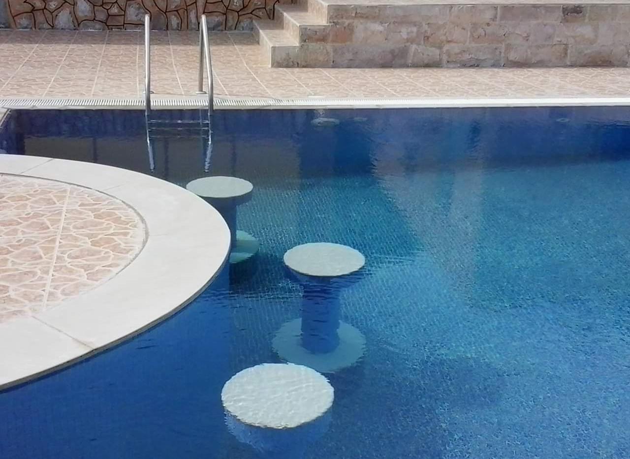 Swimming Pool with bar seats kuwait
