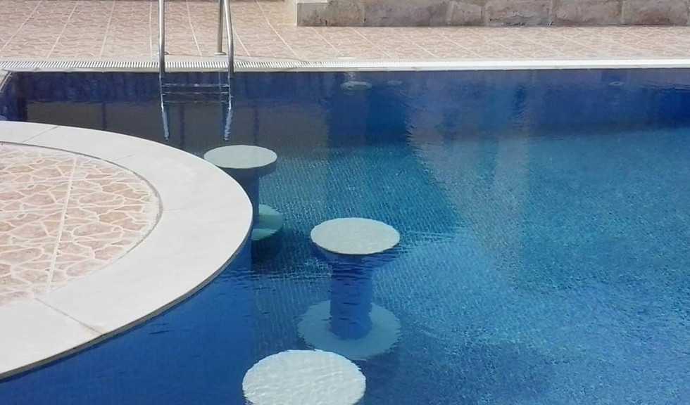 Swimming Pool with bar seats kuwait