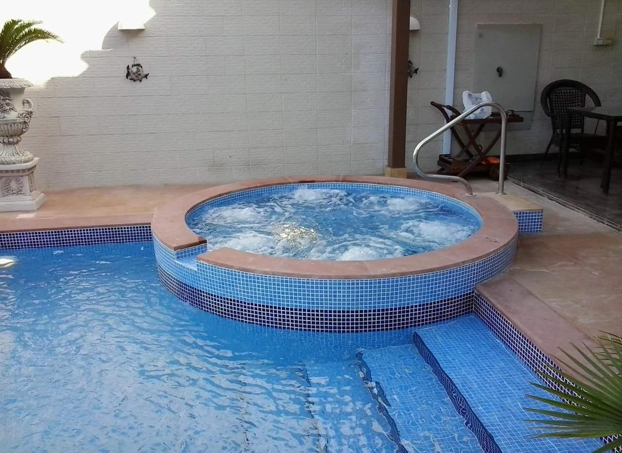 swimming pool with jaccuzi kuwait.JPG