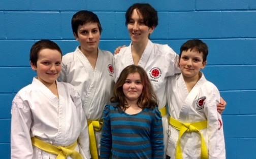 Ellis Family yellow belts.jpg
