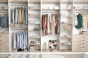 Modern wardrobe with stylish spring clothes and accessories_edited.jpg