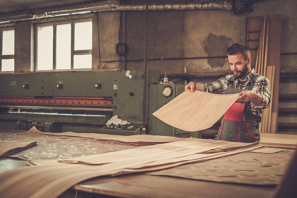Carpenter doing his job in carpentry wor