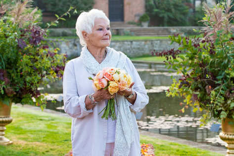 Over a natural carpet of flowers and  red roses Dame Judi Dench opens the annual RHS Wisley Flower Show 2018 at Wisley Gardens, Wisley, Surrey.