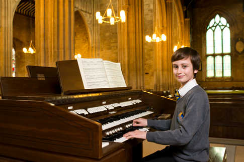 Schoolboy Louis Moss, aged 12 years, is to become the youngest person to play the organ at an Oxford College. Louis was photographed at his local church in Chipping Norton, Oxon., where he regularly practices when ther is no one else around.