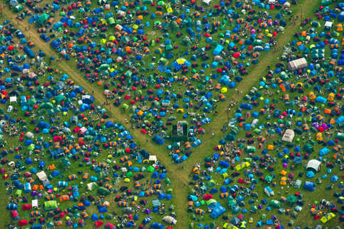Aerial photographs showing  the tent city at the Reading Festival site. Tens of thousands of people descend on the Thames Valley town which pumps  millions of pounds into the economy.