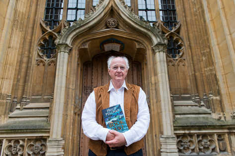 British author Philip Pullman poses with his new book 'La Belle Sauvage: The Book of Dust Volume One'.
