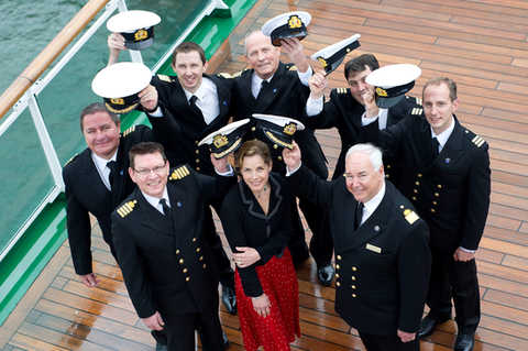 Ballerina Darcy Bussell meets officers including Commodore Steve Burgoine on board of the Azura as part of P&O Cruises 75th anniversary in Southampton.
