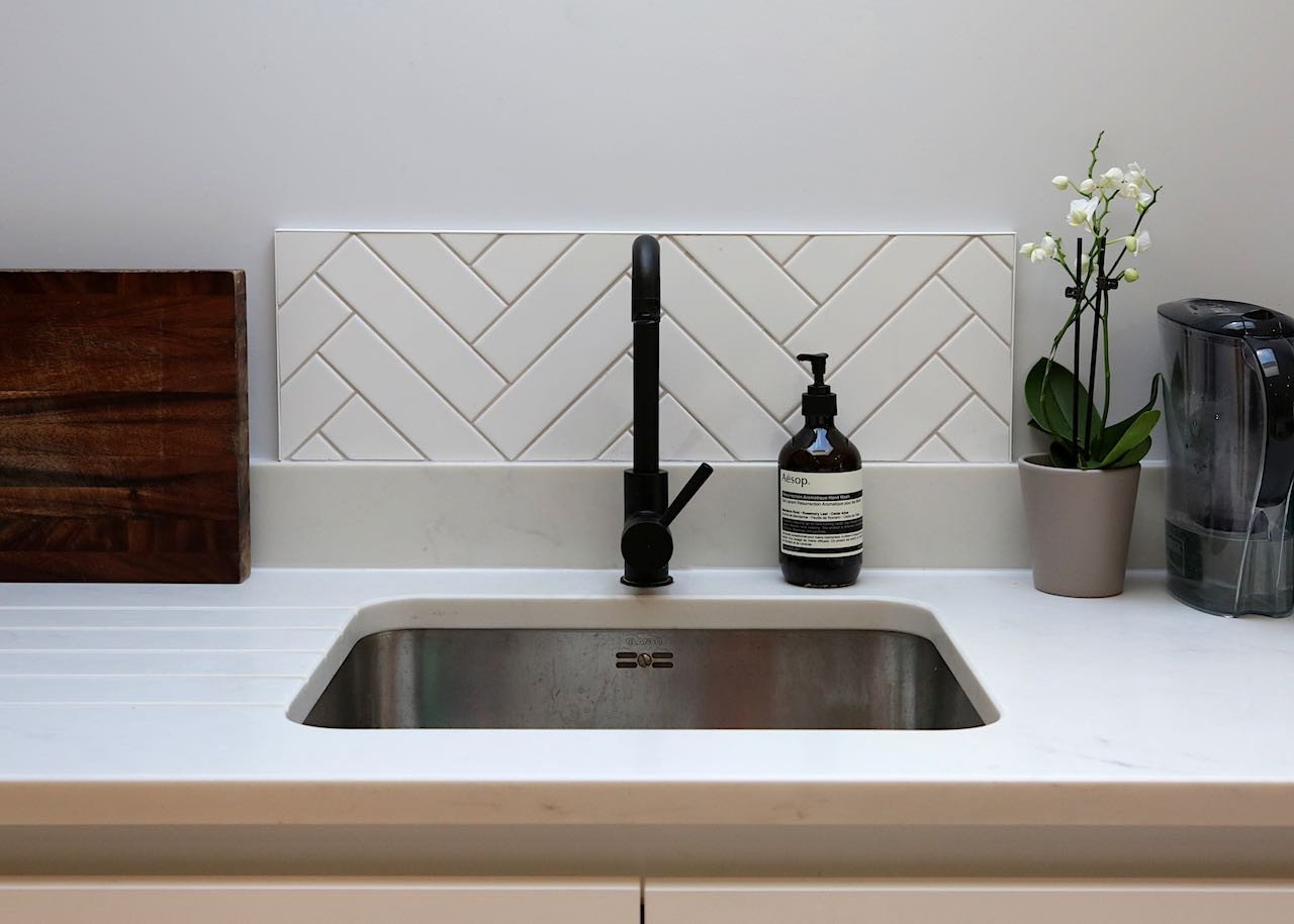 Sink with matt black tap