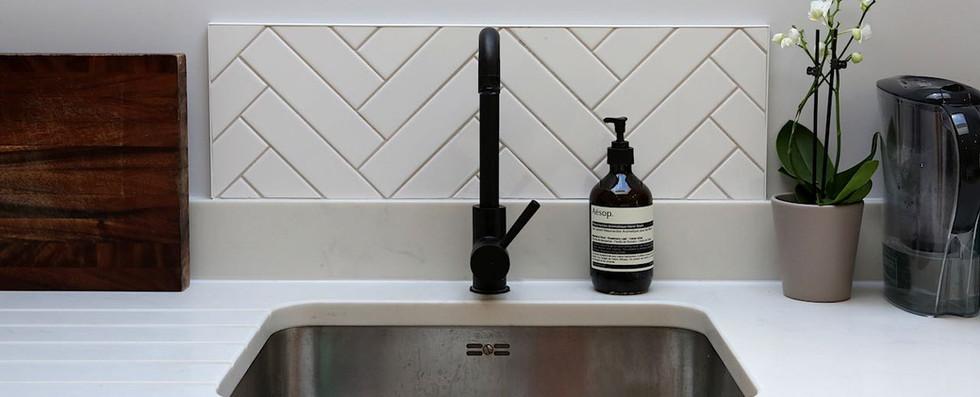 Sink with matt black tap