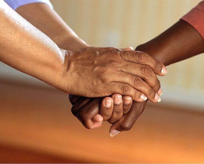 Close up view of holding hands.