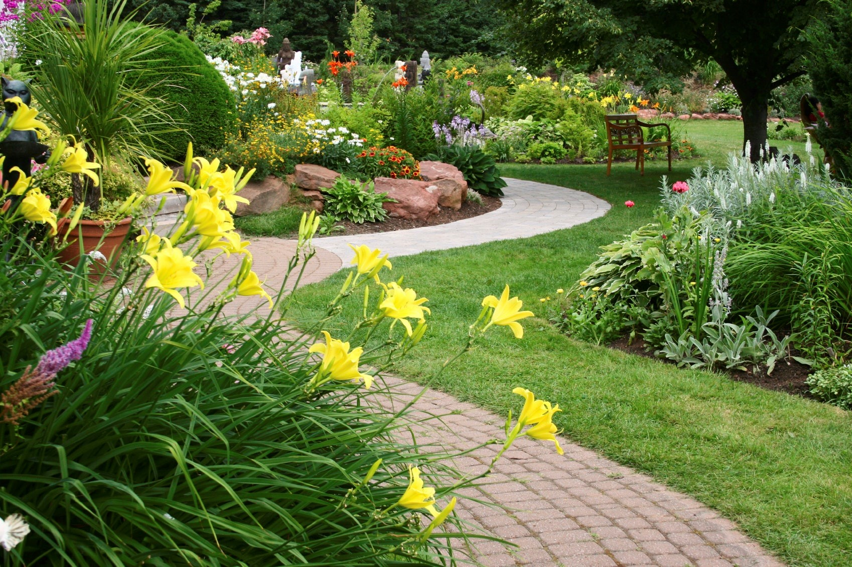 Dedicated Landscaping pic of paver path with floral.jpg
