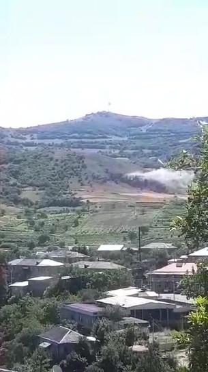 SECONDS AFTER SHELLING BERD TOWN