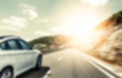 White car rushing along a high-speed hig