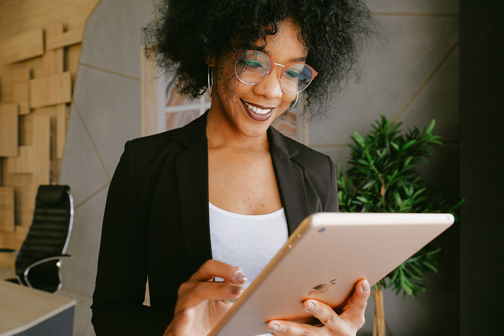 Woman using best apps for small business owners