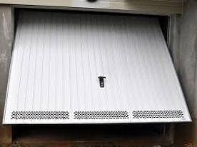 reparation-d-une-porte-de-garage-electrique-a-Paris(1).jpg