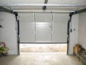 reparation-d-une-porte-de-garage-manuelle-a-Paris(1).jpg