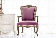 Antique chair upholstered in a light purple velvet with white gimp