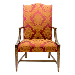 Lolling Chair with vibrant red and gold damask upholstery