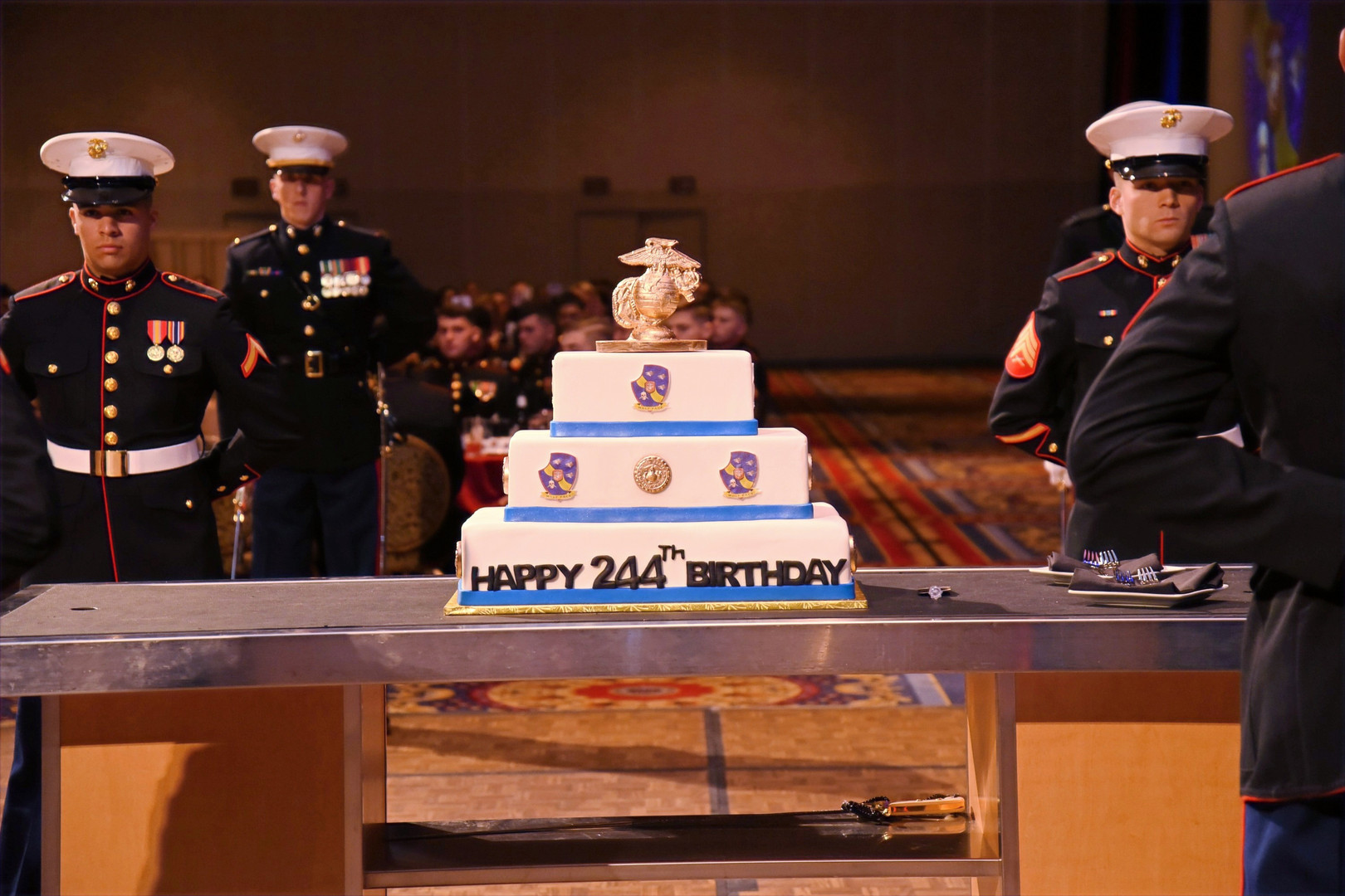 A three-tiered cake at a Marine Corps Ball.