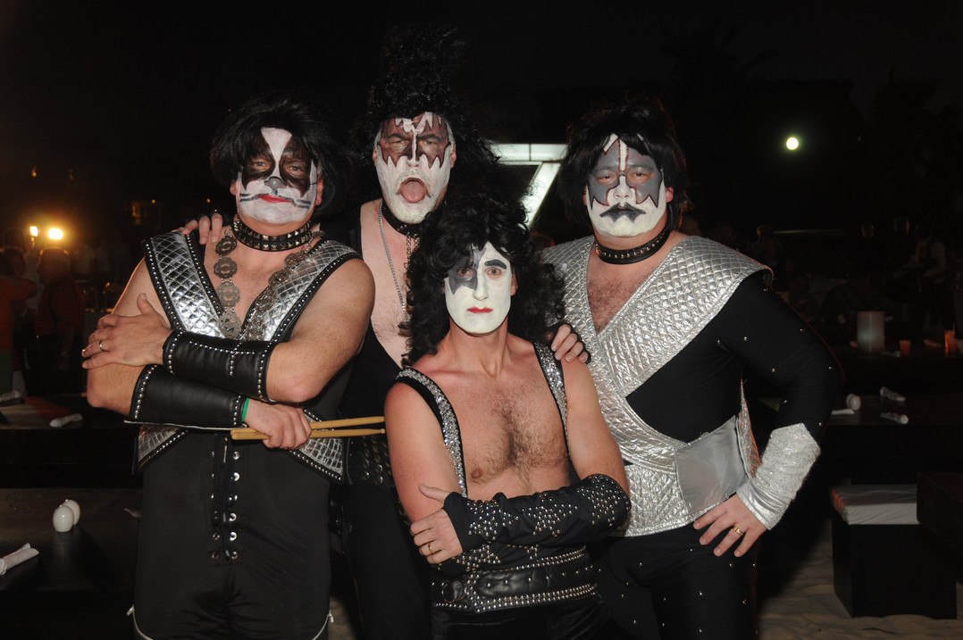 80's-themed party goers dress as KISS