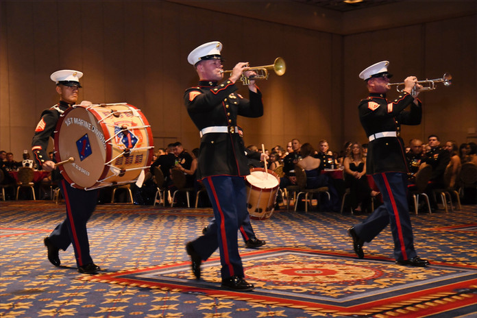 The 1st Marine Division band makes their entrance.