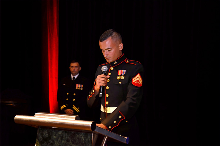 A Marine makes opening statements at 3rd LAR's Marine Corps Ball