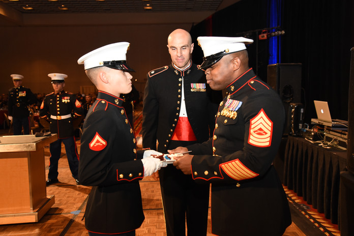 The Marine Corps birthday cake is passed from the oldest Marine present to the youngest Marine present.