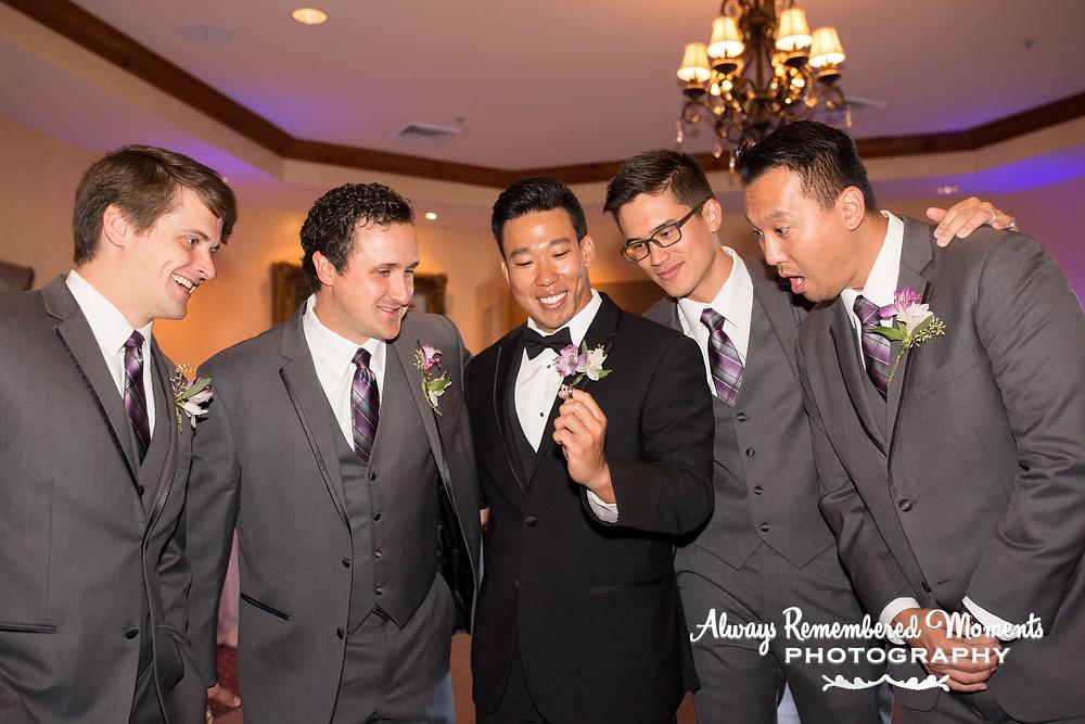 Groom injoying the wedding rings with groomsmen