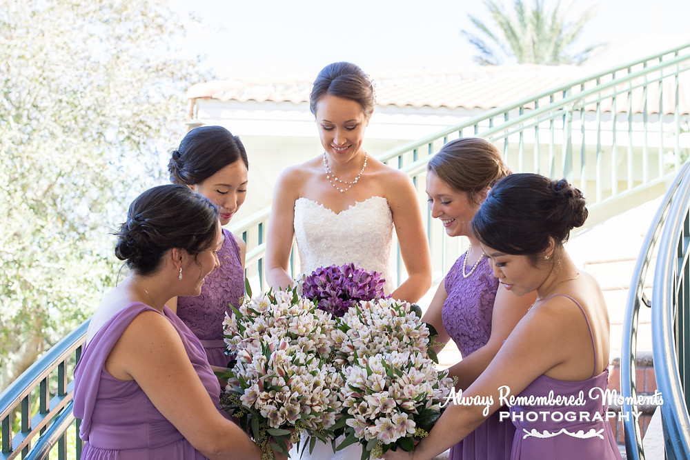 Bridal Party admiring their flowers