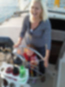 Mom and daughter having fun sailing the Kelly Allen sailing charter in Southport NC