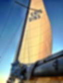 A sailboat at sunset