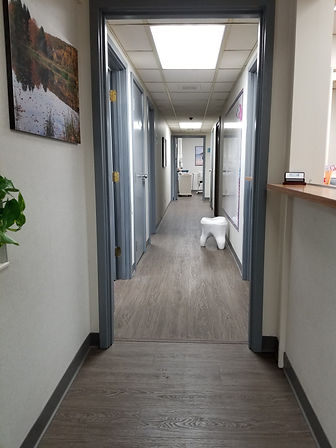 Dentist hallway and treatment area modern contemporary Middlebury Connecticut for family pediatric general and cosmetic dental care at Chase Parkway Dental
