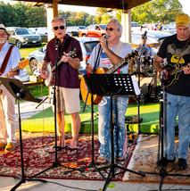 Church members Dennis, Kevin, Dave & Steve perform bluegrass favorites at Bridgewater Pavilion.