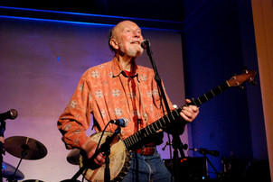 Pete Seeger performing at the first church Root Rock Revue concert