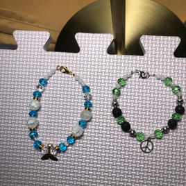 LIGHT BLUE TAIL BRACELET (Quartz, Crystal, Moonstone) $14.   GREEN PEACE BRACELET (Black Lava Beads, Green Crystal, Moonstone) $14. Annie Smith - 203-947-6675