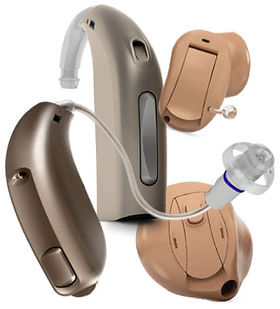 Variety of digital hearing aid styles behind-the-ear, receiver-in-the-ear, custom canal
